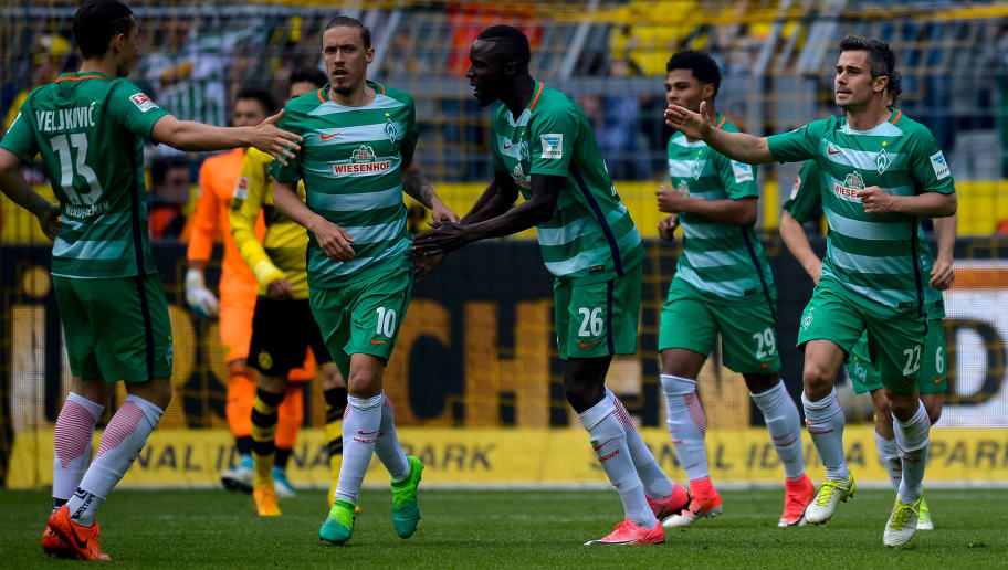Bremen's midfielder Fin Bartels celebrates scoring the 2:2 with his teammates during the German first division football match between Borussia Dortmund and Werder Bremen in Dortmund, western Germany, on May 20, 2017.  / AFP PHOTO / SASCHA SCHUERMANN / RESTRICTIONS: DURING MATCH TIME: DFL RULES TO LIMIT THE ONLINE USAGE TO 15 PICTURES PER MATCH AND FORBID IMAGE SEQUENCES TO SIMULATE VIDEO. == RESTRICTED TO EDITORIAL USE == FOR FURTHER QUERIES PLEASE CONTACT DFL DIRECTLY AT + 49 69 650050         (Photo credit should read SASCHA SCHUERMANN/AFP/Getty Images)