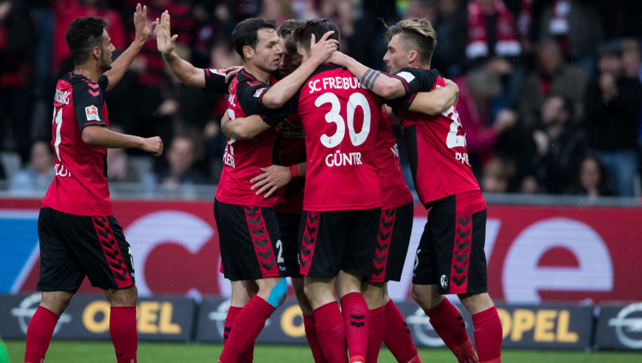 FREIBURG IM BREISGAU, GERMANY - MAY 07:  Team mates of Freiburg celebrate their first goal during the Bundesliga match between SC Freiburg and FC Schalke 04 at Schwarzwald-Stadion on May 7, 2017 in Freiburg im Breisgau, Germany.  (Photo by Simon Hofmann/Bongarts/Getty Images)