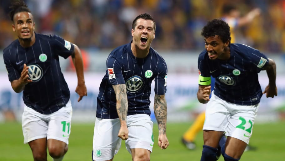 BRAUNSCHWEIG, GERMANY - MAY 29:  Vieirinha (C) of Wolfsburg celebrates his team's first goal with team mates Daniel Didavi (L) and Luiz Gustavo during the Bundesliga Playoff leg 2 match between Eintracht Braunschweig and VfL Wolfsburg at Eintracht Stadion on May 29, 2017 in Braunschweig, Germany.  (Photo by Martin Rose/Bongarts/Getty Images)