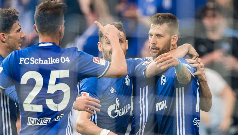 GELSENKIRCHEN, GERMANY - MAY 13: Players of Schalke celebrate their teams first goal scoring by Guido Burgstaller (R) during the Bundesliga match between FC Schalke 04 and Hamburger SV at Veltins-Arena on May 13, 2017 in Gelsenkirchen, Germany. (Photo by Lukas Schulze/Bongarts/Getty Images)