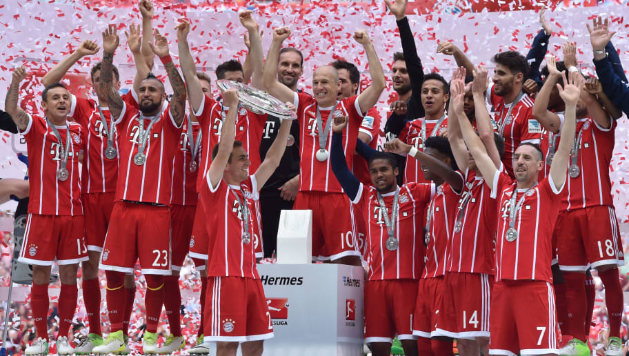 Bayern Munich's defender Philipp Lahm holds the trophy as Bayern Munich's players celebrate after the German first division Bundesliga football match FC Bayern Munich vs SC Freiburg, his last match for the club, in the southern German city of Munich on May 20, 2017. / AFP PHOTO / Christof Stache / RESTRICTIONS: DURING MATCH TIME: DFL RULES TO LIMIT THE ONLINE USAGE TO 15 PICTURES PER MATCH AND FORBID IMAGE SEQUENCES TO SIMULATE VIDEO. == RESTRICTED TO EDITORIAL USE == FOR FURTHER QUERIES PLEASE CONTACT DFL DIRECTLY AT + 49 69 650050         (Photo credit should read CHRISTOF STACHE/AFP/Getty Images)