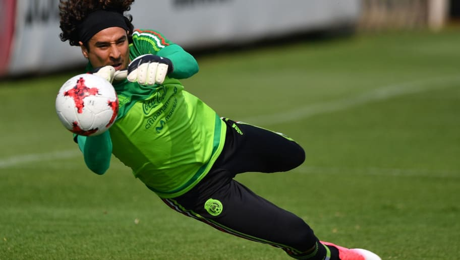 Mexico's national football team goalkeeper Guillermo Ochoa attempts to stop the ball during a training session ahead of the World Cup qualifier against Honduras and the United States at the High Performance Center (CAR) on the outskirts of Mexico City on May 23, 2017.  / AFP PHOTO / YURI CORTEZ        (Photo credit should read YURI CORTEZ/AFP/Getty Images)