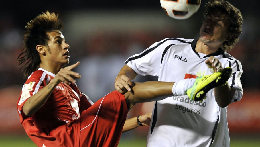 Brazilian Santos FC footballer Neymar (L) vies for the ball with Rubens Jr (R) during a charity football match organized by former Brazilian national team player Zico, at Morumbi stadium in Sao Paulo, Brazil, on December 28, 2011. AFP PHOTO / Nelson ALMEIDA (Photo credit should read NELSON ALMEIDA/AFP/Getty Images)