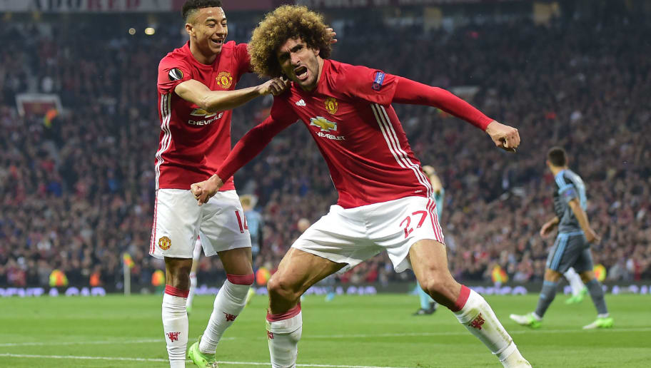 Belgian midfielder Marouane Fellaini celebrates with Manchester United's English midfielder Jesse Lingard (L) after scoring the opening goal of the UEFA Europa League semi-final, second-leg football match between Manchester United and Celta Vigo at Old Trafford stadium in Manchester, north-west England, on May 11, 2017. / AFP PHOTO / Miguel RIOPA        (Photo credit should read MIGUEL RIOPA/AFP/Getty Images)