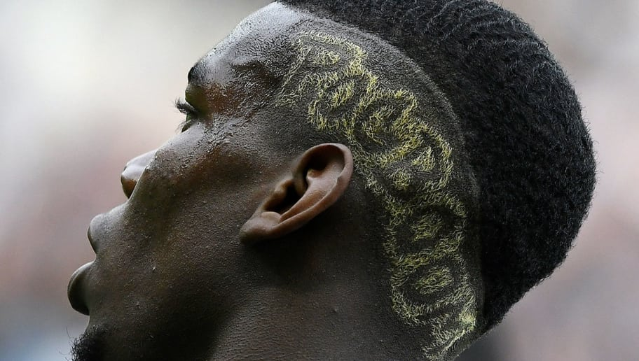 A photo taken on May 30, 2016 shows a detail of France's midfielder Paul Pogba's haistyle during the friendly football match between France and Cameroon at the Beaujoire Stadium in Nantes, western France.  France won 3-2.  / AFP / FRANCK FIFE        (Photo credit should read FRANCK FIFE/AFP/Getty Images)