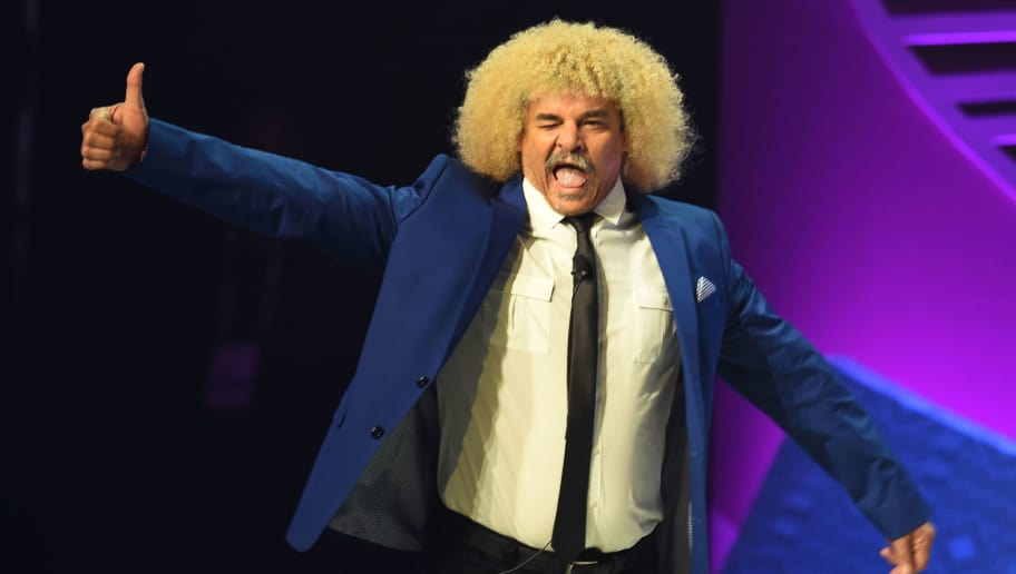 Former Colombian football player Carlos Valderrama arrives on stage during the draw for the Copa America Centenario 2016 championship at the Hammerstein Ballroom in New York on February 21, 2016.  The Copa America Centenario, a once-in-a-lifetime soccer summer event, which honors 100 years of the Copa America tournament, will take place in the US from June 3-26, 2016. / AFP / Mladen ANTONOV        (Photo credit should read MLADEN ANTONOV/AFP/Getty Images)