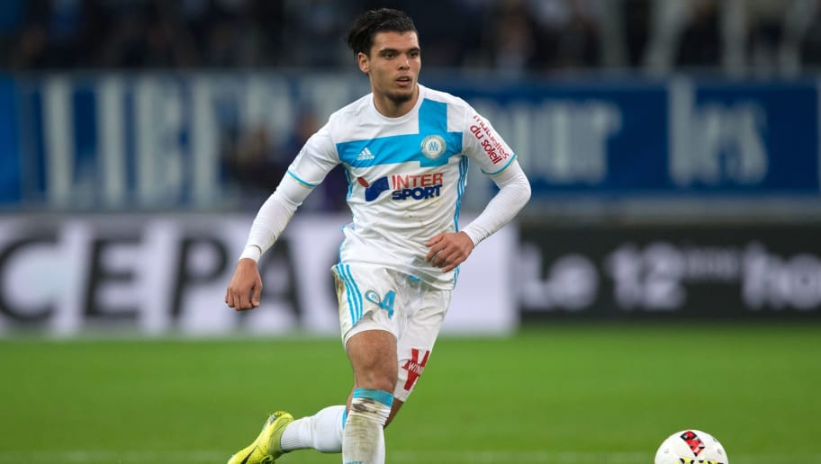 Olympique de Marseille's Dutch defender Karim Rekik runs with the ball during the French L1 football match between Olympique de Marseille and Stade Malherbe de Caen on November 20, 2016 at the Velodrome stadium in Marseille, southern France.  / AFP / BERTRAND LANGLOIS        (Photo credit should read BERTRAND LANGLOIS/AFP/Getty Images)
