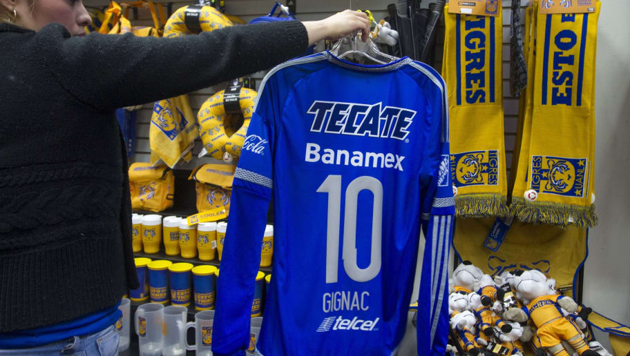 18fd57612 A woman shows a jersey with the number and name of French footballer Andre  Pierre Gignac
