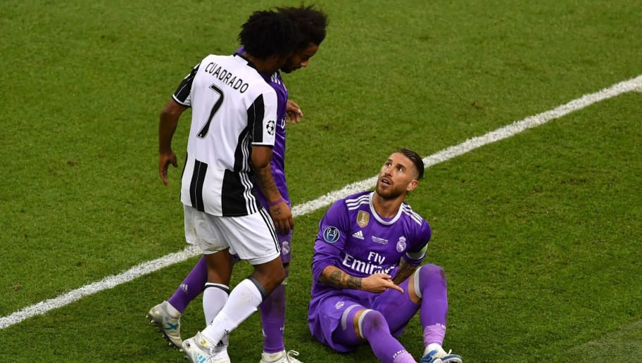 Real Madrid's Spanish defender Sergio Ramos (1st-R) watches Juventus' Colombian midfielder Juan Cuadrado after provoking his red card during the UEFA Champions League final football match between Juventus and Real Madrid at The Principality Stadium in Cardiff, south Wales, on June 3, 2017. / AFP PHOTO / Ben STANSALL        (Photo credit should read BEN STANSALL/AFP/Getty Images)