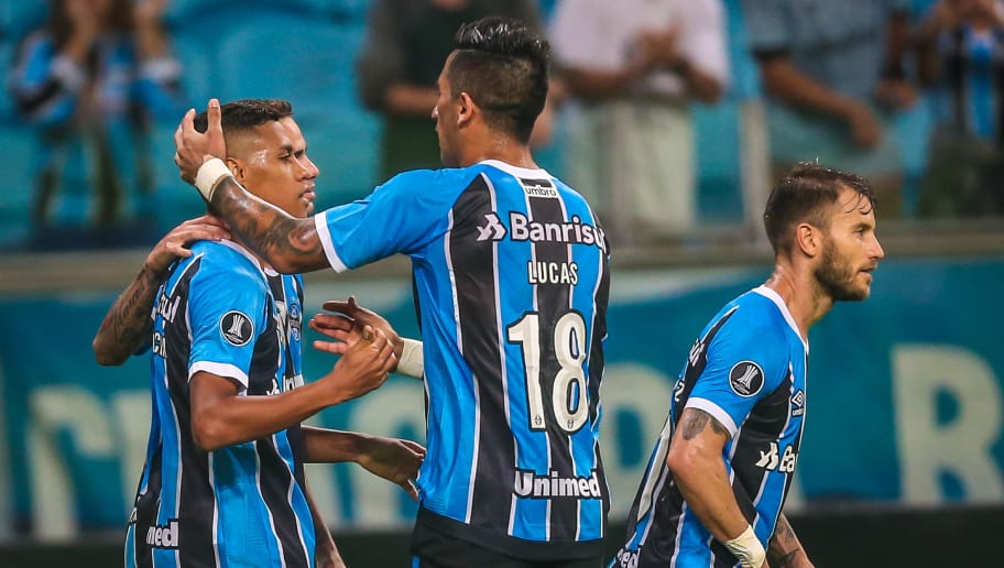 Pedro Rocha of Gremio celebrates with teammates after scoring against Venezuela's Zamora, during their Copa Libertadores football match at the Arena do Gremio stadium in Porto Alegre, Brazil on May 25, 2017. / AFP PHOTO / Jefferson BERNARDES        (Photo credit should read JEFFERSON BERNARDES/AFP/Getty Images)
