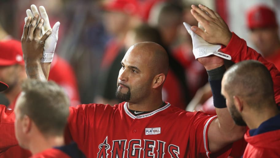 ANAHEIM, CALIFORNIA - JUNE 03:  Albert Pujols #5 of the Los Angeles Angels of Anaheim celebrates with teammates in the dugout after hitting career home run number 600, a grand slam in the fourth inning against the Minnesota Twins at Angel Stadium of Anaheim on June 3, 2017 in Anaheim, California.  (Photo by Stephen Dunn/Getty Images)