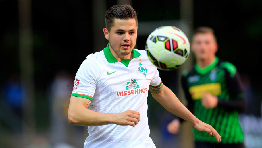 BREMEN, GERMANY - MAY 27:  Marnon Busch of Bremen II plays the ball  during the match between Werder Bremen II and Borussia Moenchengladbach II at Platz 11 on May 27, 2015 in Bremen, Germany.  (Photo by Martin Stoever/Bongarts/Getty Images)