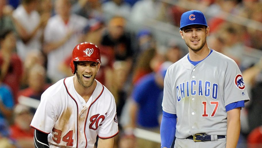 WASHINGTON, DC - JUNE 14:  Bryce Harper #34 of the Washington Nationals talks with Kris Bryant #17 of the Chicago Cubs during the eighth inning at Nationals Park on June 14, 2016 in Washington, DC. Chicago won the game 4-3.  (Photo by Greg Fiume/Getty Images)