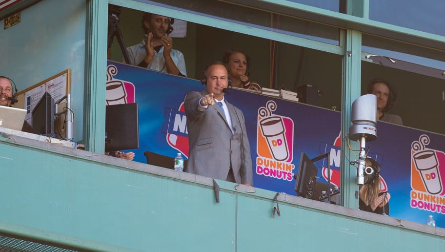 BOSTON, MA - SEPTEMBER 27: Don Orsillo points from the booth during his last game as the play-by-play announcer for Boston Red Sox games on the New England Sports Network, waves to the crowd after a video tribute during the seventh inning at Fenway Park on September 27, 2015 in Boston, Massachusetts. (Photo by Rich Gagnon/Getty Images)