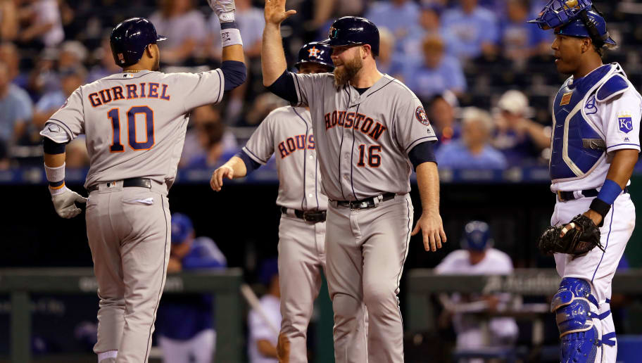 KANSAS CITY, MO - JUNE 05:  Yuli Gurriel #10 of the Houston Astros is congratulated by Brian McCann #16 at home plate after hitting a 3-run home run during the 9th inning of the game against the Kansas City Royals at Kauffman Stadium on June 5, 2017 in Kansas City, Missouri.  The Astros defeated the Royals with a final score of 7-3.  (Photo by Jamie Squire/Getty Images)
