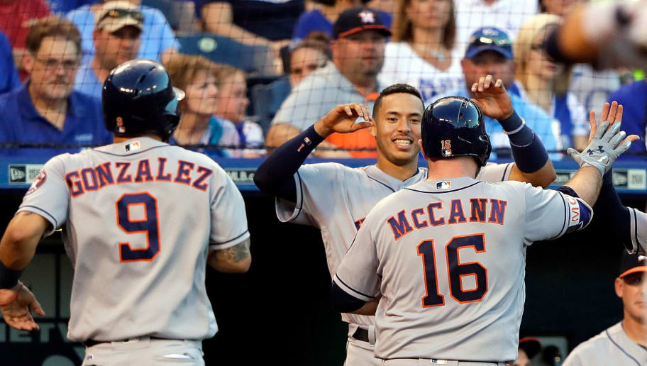 KANSAS CITY, MO - JUNE 05:  Brian McCann #16 of the Houston Astros is congratulated by teammates after hitting a home run during the 4th inning of the game against the Kansas City Royals at Kauffman Stadium on June 5, 2017 in Kansas City, Missouri.  (Photo by Jamie Squire/Getty Images)