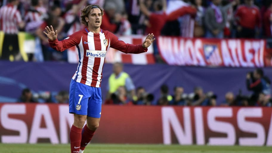 45ff14fd8 TOPSHOT - Atletico Madrid s French forward Antoine Griezmann celebrates a  goal during the UEFA Champions League