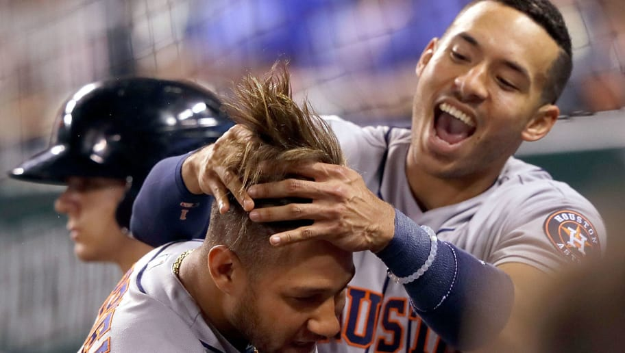 KANSAS CITY, MO - JUNE 05:  Yuli Gurriel #10 of the Houston Astros is congratulated by Carlos Correa #1 after hitting a 3-run home run during the 9th inning of the game against the Kansas City Royals at Kauffman Stadium on June 5, 2017 in Kansas City, Missouri.  The Astros defeated the Royals with a final score of 7-3.  (Photo by Jamie Squire/Getty Images)