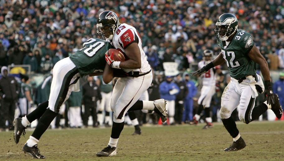 PHILADELPHIA - JANUARY 23:  Tightend Alge Crumpler #83 of the Atlanta Falcons is hit by Brian dawkins #20 of the Philadelphia Eagles in the second quarter during the NFC Championship game at Lincoln Financial Field on January 23, 2005 in Philadelphia, Pennsylvannia.  (Photo by Brian Bahr/Getty Images)