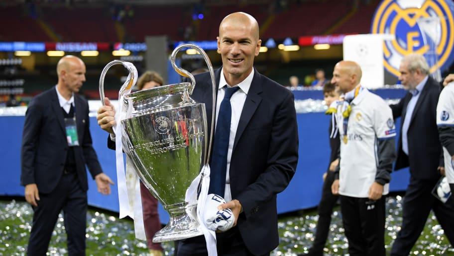 CARDIFF, WALES - JUNE 03:  Zinedine Zidane, Manager of Real Madrid poses with the Champions League Trophy after the UEFA Champions League Final between Juventus and Real Madrid at National Stadium of Wales on June 3, 2017 in Cardiff, Wales.  (Photo by Matthias Hangst/Getty Images)