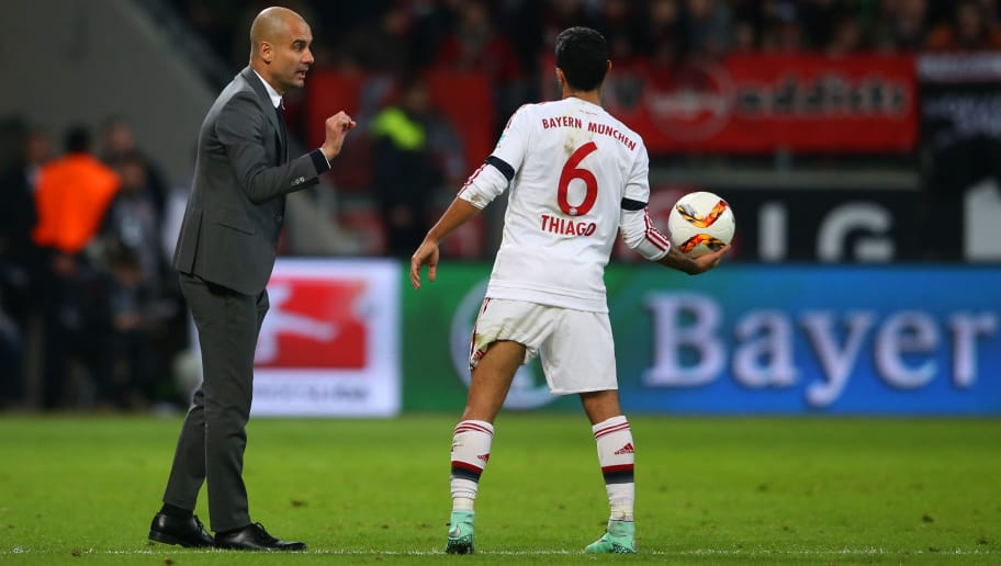 LEVERKUSEN, GERMANY - FEBRUARY 06:  Josep Guardiola, Head Coach of FC Bayern Muenchen speaks with Thiago of FC Bayern Muenchen during the Bundesliga match between Bayer Leverkusen and FC Bayern Muenchen at BayArena on February 6, 2016 in Leverkusen, Germany.  (Photo by Lars Baron/Bongarts/Getty Images)