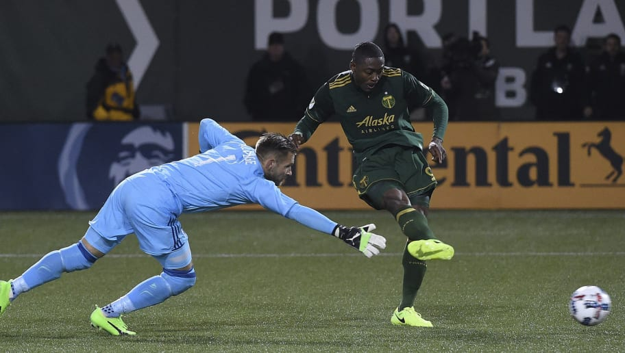 PORTLAND, OR - MARCH 03: Fanendo Adi #9 of Portland Timbers scores a goal on John Alvbage #1 of Minnesota United during the second half of the match against the Minnesota United at Providence Park on March 3, 2017 in Portland, Oregon. The Timbers won the game 5-1.  (Photo by Steve Dykes/Getty Images)