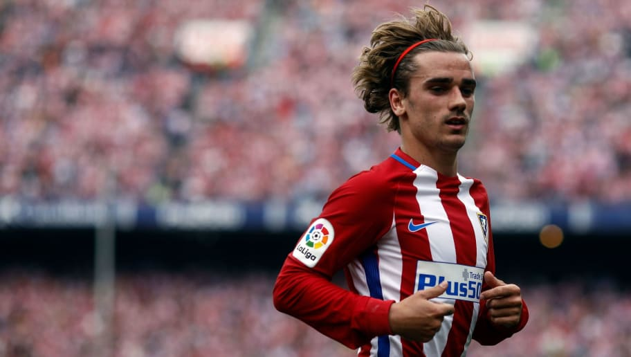 Atletico de Madrid's forward Griezmann runs during the Spanish league football match Club Atletico de Madrid vs Athletic Club Bilbao at the Vicente Calderon stadium in Madrid on May 21, 2017. / AFP PHOTO / OSCAR DEL POZO        (Photo credit should read OSCAR DEL POZO/AFP/Getty Images)