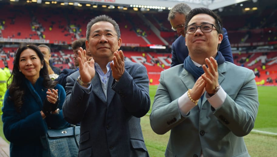 MANCHESTER, ENGLAND - MAY 01:  Chairman of Leicester City Vichai Srivaddhanaprabha (C) and son Aiyawatt Srivaddhanaprabha acknowledge the fans after the Barclays Premier League match between Manchester United and Leicester City at Old Trafford on May 1, 2016 in Manchester, England.  (Photo by Michael Regan/Getty Images)