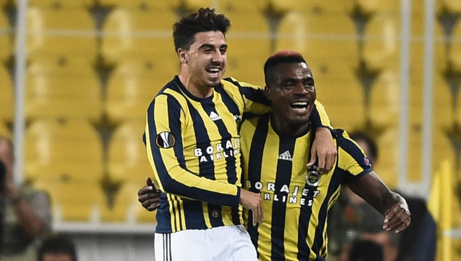 Fenerbahce's Nigerian forward Emmanuel Emenike (R) celebrates with his teammate Ozan Tufan (C) after scoring a goal during the UEFA Europa League football match between Fenerbahce and Feyenoord at the Fenerbahce Ulker Stadium in Istanbul on September 29, 2016.  / AFP / OZAN KOSE        (Photo credit should read OZAN KOSE/AFP/Getty Images)
