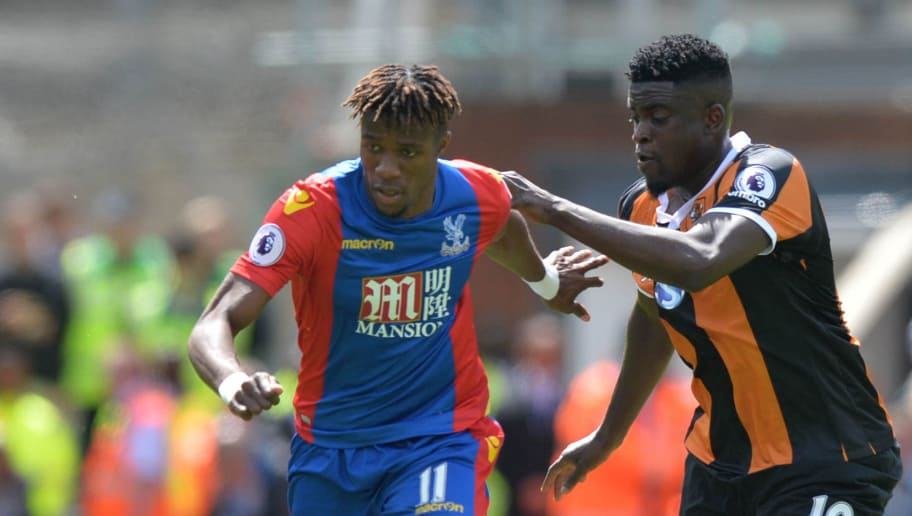 Crystal Palace's Ivorian striker Wilfried Zaha (L) vies with Hull City's French midfielder Alfred N'Diaye during the English Premier League football match between Crystal Palace and Hull City at Selhurst Park in south London on May 14, 2017 / AFP PHOTO / OLLY GREENWOOD / RESTRICTED TO EDITORIAL USE. No use with unauthorized audio, video, data, fixture lists, club/league logos or 'live' services. Online in-match use limited to 75 images, no video emulation. No use in betting, games or single club/league/player publications.  /         (Photo credit should read OLLY GREENWOOD/AFP/Getty Images)