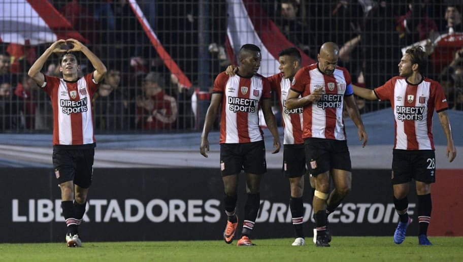 Argentina's Estudiantes de La Plata midfielder Augusto Solari (L) celebrates next to teammates after scoring against Brazil's Botafogo during the Copa Libertadores group 1 football match at Ciudad de Quilmes stadium on the outskirts of Buenos Aires on May 25, 2017. / AFP PHOTO / JUAN MABROMATA        (Photo credit should read JUAN MABROMATA/AFP/Getty Images)