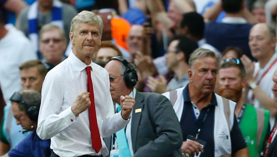 Arsenal's French manager Arsene Wenger celebrates at the final whistle in the English FA Cup final football match between Arsenal and Chelsea at Wembley stadium in London on May 27, 2017. Aaron Ramsey scored a 79th-minute header to earn Arsenal a stunning 2-1 win over Double-chasing Chelsea on Saturday and deliver embattled manager Arsene Wenger a record seventh FA Cup. / AFP PHOTO / Ian KINGTON / NOT FOR MARKETING OR ADVERTISING USE / RESTRICTED TO EDITORIAL USE        (Photo credit should read IAN KINGTON/AFP/Getty Images)