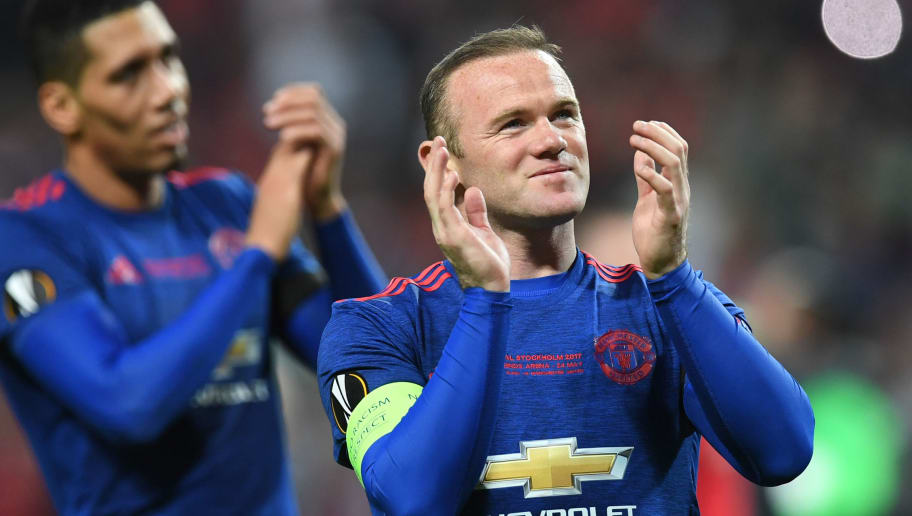Manchester United's English striker Wayne Rooney (R) reacts after victory in the UEFA Europa League final football match Ajax Amsterdam v Manchester United on May 24, 2017 at the Friends Arena in Solna outside Stockholm. / AFP PHOTO / Paul ELLIS        (Photo credit should read PAUL ELLIS/AFP/Getty Images)
