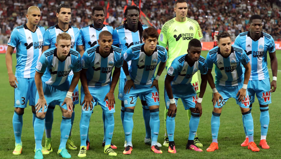 Marseille's players, (front row, LtoR) Marseille's Slovak defender Tomas Hubocan, Marseille's French midfielder William Vainqueur, Marseille's Japanese defender Hiroki Sakai, Marseille's Guinean midfielder Bouna Sarr, Marseille's midfielder Florian Thauvin, Marseille's Belgian forward Aaron Leya Iseka and (back row, LtoR) Marseille's Brazilian defender Matheus Doria, Marseille's Dutch defender Karim Rekik, Marseille's Cameroonian midfielder Andre Anguissa, Marseille's French forward Bafétimbi Gomis and Marseille's French goalkeeper Yohann Pele pose for a team photo before the French L1 football match Nice vs Marseille on September 11, 2016 at the Allianz Riviera stadium in Nice, southeastern France. / AFP / VALERY HACHE        (Photo credit should read VALERY HACHE/AFP/Getty Images)
