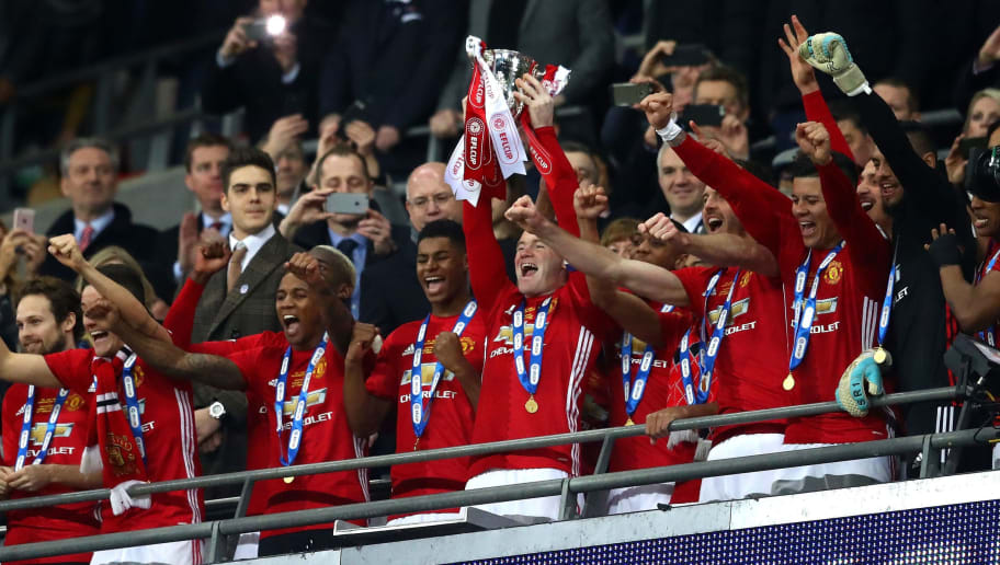 LONDON, ENGLAND - FEBRUARY 26:  Wayne Rooney of Manchester United lifts the trophy in victory after during the EFL Cup Final between Manchester United and Southampton at Wembley Stadium on February 26, 2017 in London, England. Manchester United beat Southampton 3-2.  (Photo by Michael Steele/Getty Images)