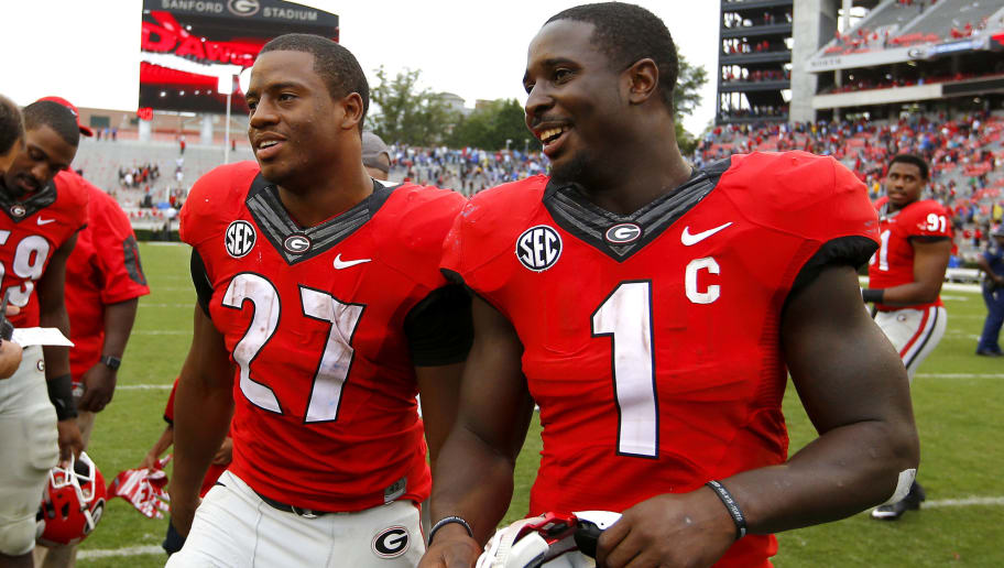 ATHENS, GA - SEPTEMBER 26: Running back Nick Chubb #27 of the Georgia Bulldogs celebrates with running back Sony Michel #1 at the conclusion of the game against the Southern University Jaguars on September 26, 2015 at Sanford Stadium in Athens, Georgia. The Georgia Bulldogs won 48-6. (Photo by Todd Kirkland/Getty Images)