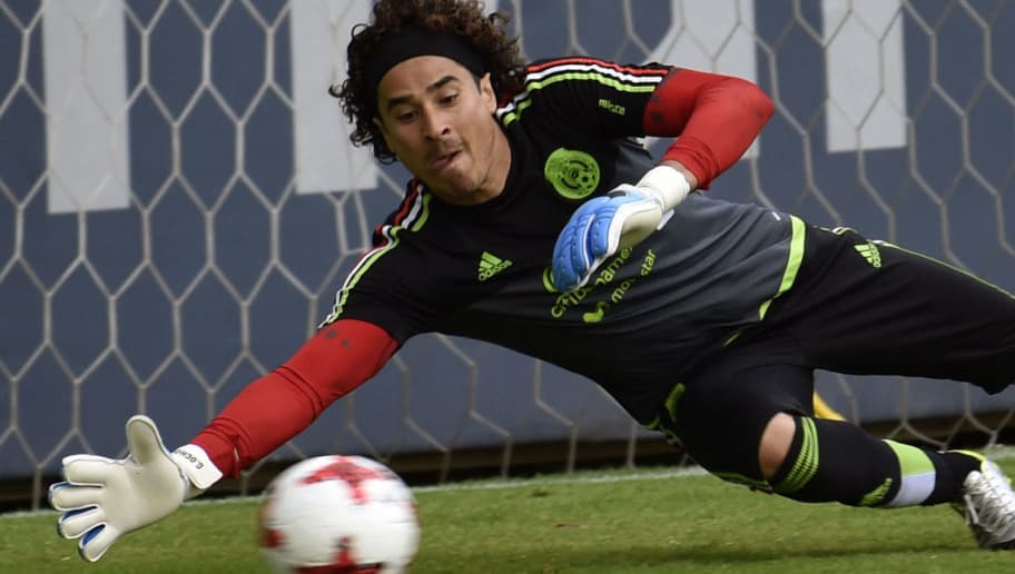 Mexico's national football team goalkeeper Guillermo Ochoa takes part in a training session ahead of the World Cup qualifier against Honduras and the United States at the High Performance Center (CAR) on the outskirts of Mexico City on June 5, 2017. / AFP PHOTO / PEDRO PARDO        (Photo credit should read PEDRO PARDO/AFP/Getty Images)