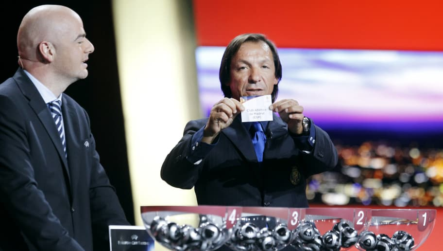 Former Portuguese player Fernando Gomes (R) and UEFA's general secretary Gianni Infantino (L) proceed to the draw for the 2011/2012 Europa League group stage on August 26, 2011 in Monaco. AFP PHOTO SEBASTIEN NOGIER (Photo credit should read SEBASTIEN NOGIER/AFP/Getty Images)