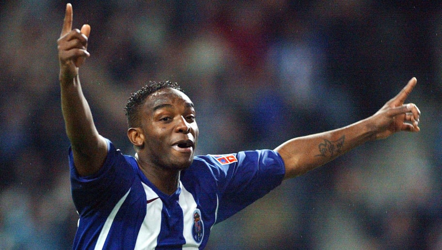 Porto, PORTUGAL:  FC Porto's South African player Benny McCarthy celebrates after scoring against Sporting CP during their Portuguese Cup semifinal football match at Dragao Stadium in Porto, northern Portugal, 22 March 2006. FC Porto reaches the final after winning the match. AFP PHOTO / Miguel RIOPA  (Photo credit should read MIGUEL RIOPA/AFP/Getty Images)