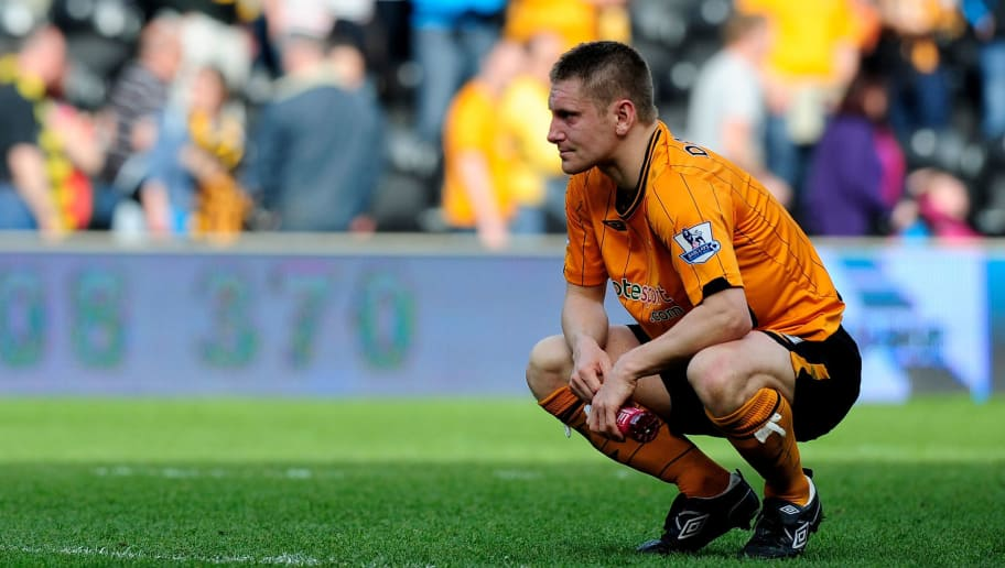 HULL, ENGLAND - APRIL 24:  Dejection for Andy Dawson of Hull City  after the Barclays Premier League match between Hull City and Sunderland at the KC Stadium on April 24, 2010 in Hull, England.  (Photo by Jamie McDonald/Getty Images)