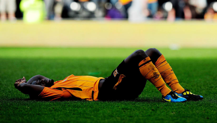 HULL, ENGLAND - APRIL 24:  Dejection for Bernard Mendy of Hull City after the Barclays Premier League match between Hull City and Sunderland at the KC Stadium on April 24, 2010 in Hull, England.  (Photo by Jamie McDonald/Getty Images)