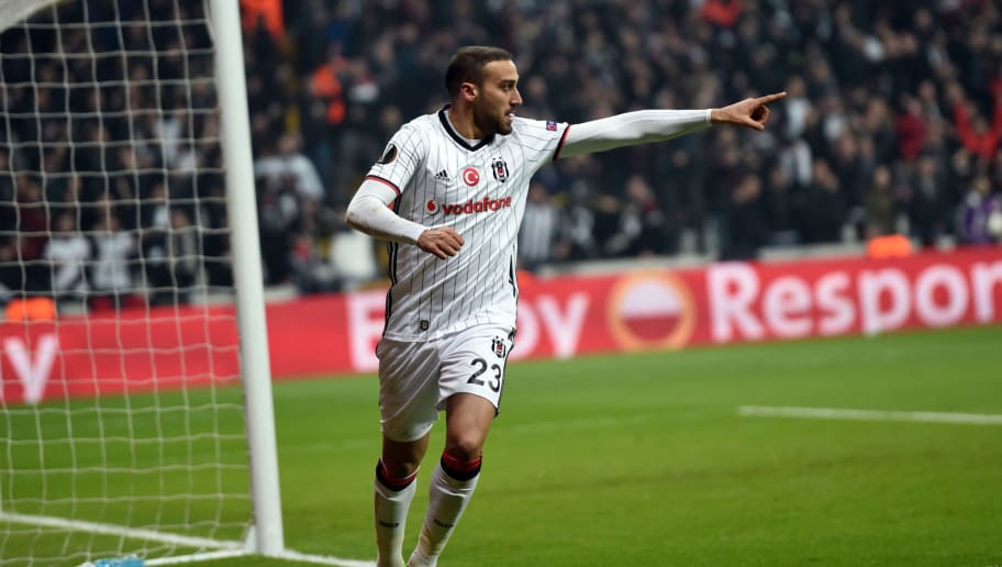 Besiktas' Cenk Tosun  celebrates after scoring a goal  during their UEFA Europa League round of 16 second leg football match between Besiktas JK and Olympiacos Piraeus on March 16, 2017 at the Vodafone arena stadium in Istanbul. / AFP PHOTO / BULENT KILIC        (Photo credit should read BULENT KILIC/AFP/Getty Images)