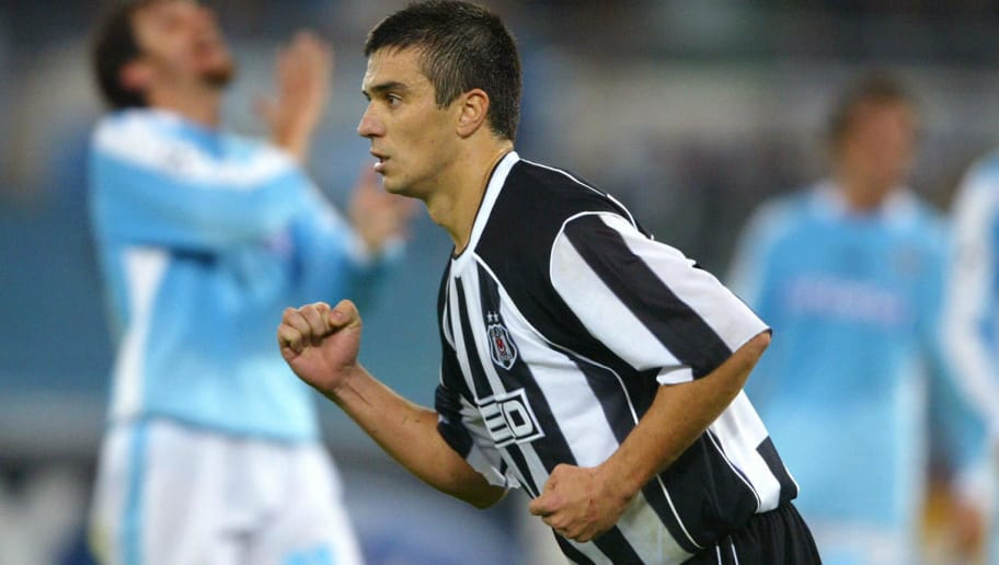ROME, ITALY:  Besiktas Daniel Pancu celebrates after scoring a penalty against Lazio during their Champions league Group match at Rome's Olympic stadium 26 November  2003.         AFP PHOTO PAOLO COCCO  (Photo credit should read PAOLO COCCO/AFP/Getty Images)
