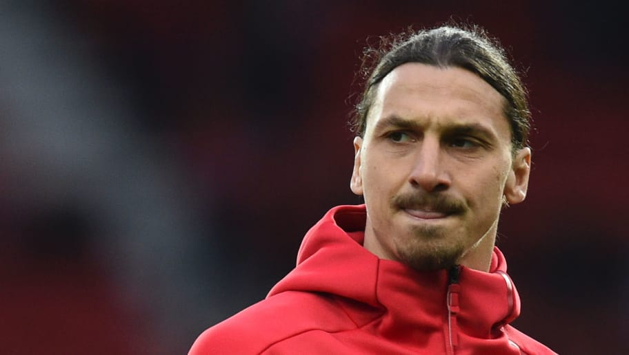 Manchester United's Swedish striker Zlatan Ibrahimovic warms up before the UEFA Europa League quarter-final second leg football match between Manchester United and Anderlecht at Old Trafford in Manchester, north west England, on April 20, 2017. / AFP PHOTO / Oli SCARFF        (Photo credit should read OLI SCARFF/AFP/Getty Images)