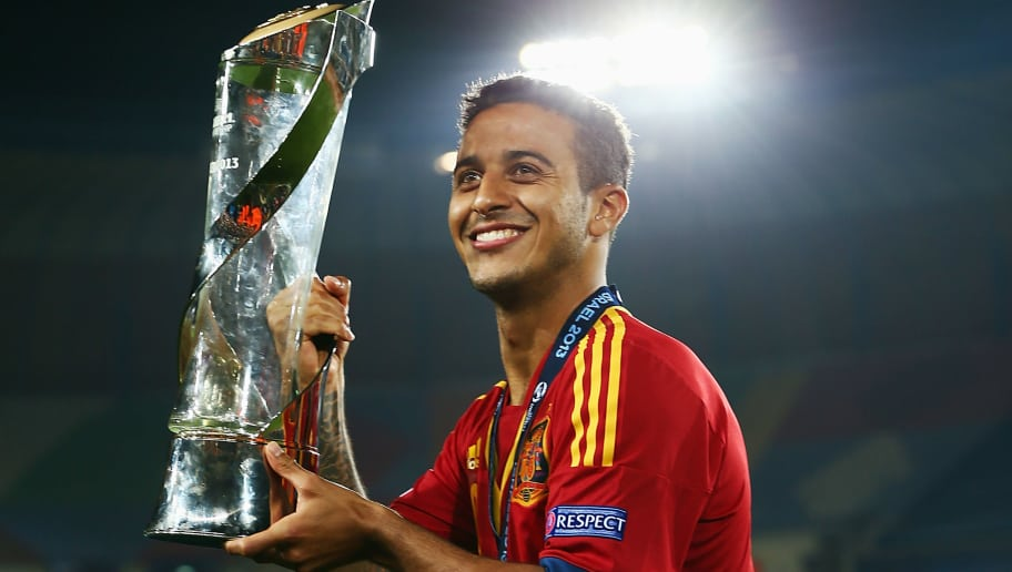 JERUSALEM, ISRAEL - JUNE 18:  Thiago Alcantara of Spain poses with the trophy after winning the UEFA European U21 Championship final match against Italy at Teddy Stadium on June 18, 2013 in Jerusalem, Israel.  (Photo by Alex Grimm/Getty Images)