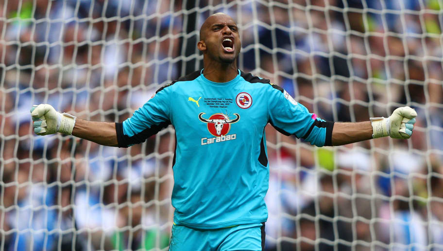 LONDON, ENGLAND - MAY 29:  Ali Al-Habsi of Reading celebrates saving a penalty from Michael Hefele of Huddersfield Town (not pictured) during the penalty shoot out during the Sky Bet Championship play off final between Huddersfield and Reading at Wembley Stadium on May 29, 2017 in London, England.  (Photo by Ian Walton/Getty Images)