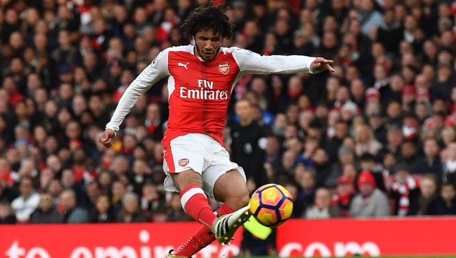 Arsenal's Egyptian midfielder Mohamed Elneny has an unsuccessful shot during the English Premier League football match between Arsenal and Bournemouth at the Emirates Stadium in London on November 27, 2016.  / AFP / Ben STANSALL / RESTRICTED TO EDITORIAL USE. No use with unauthorized audio, video, data, fixture lists, club/league logos or 'live' services. Online in-match use limited to 75 images, no video emulation. No use in betting, games or single club/league/player publications.  /         (Photo credit should read BEN STANSALL/AFP/Getty Images)