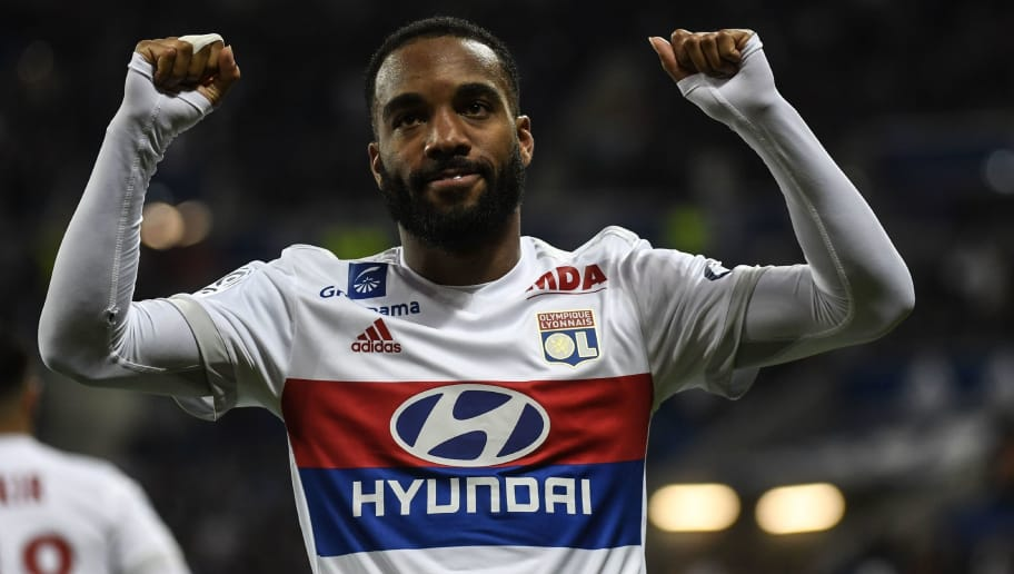 Lyon's French forward Alexandre Lacazette reacts after scoring during the French L1 football match between Lyon (OL) and Nice (OGCN) on May 20, 2017, at the Parc Olympique Lyonnais stadium in Decines-Charpieu near Lyon, central-eastern  France. / AFP PHOTO / PHILIPPE DESMAZES        (Photo credit should read PHILIPPE DESMAZES/AFP/Getty Images)