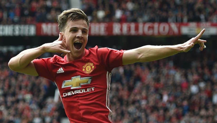 Manchester United's English midfielder Josh Harrop celebrates scoring thei opening goal during the English Premier League football match between Manchester United and Cyrstal Palace at Old Trafford in Manchester, north west England, on May 21, 2017. / AFP PHOTO / Oli SCARFF / RESTRICTED TO EDITORIAL USE. No use with unauthorized audio, video, data, fixture lists, club/league logos or 'live' services. Online in-match use limited to 75 images, no video emulation. No use in betting, games or single club/league/player publications.  /         (Photo credit should read OLI SCARFF/AFP/Getty Images)
