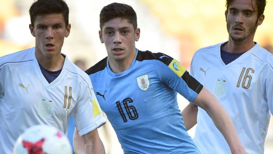 Italy's midfielder Matteo Pessina (L), Uruguay's midfielder Federico Valverde (C) and Italy's midfielder Francesco Cassata watch the ball during the U-20 World Cup third place play-off football match between Uruguay and Italy in Suwon on June 11, 2017.  / AFP PHOTO / KIM DOO-HO        (Photo credit should read KIM DOO-HO/AFP/Getty Images)